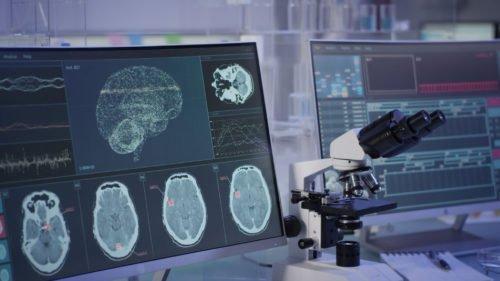 Futuristic laboratory equipment. Brainwave scanning research on computer screens